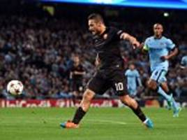 manchester city 1-1 roma: francesco totti's record-breaking goal cancels out early sergio aguero penalty in champions league